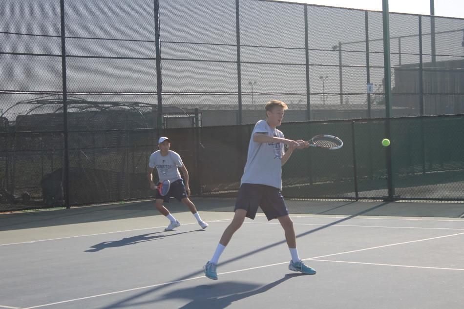 Edgar Munoz (left) and David Evans (right) playing their last doubles match set, ultimately winning 8-5. Photo credit: Armando Jacobo