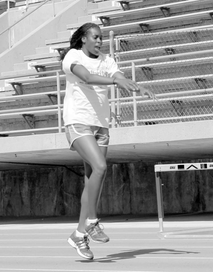 Alexus Dalton warms up on the track before practice. Photo credit: Luis Guzman
