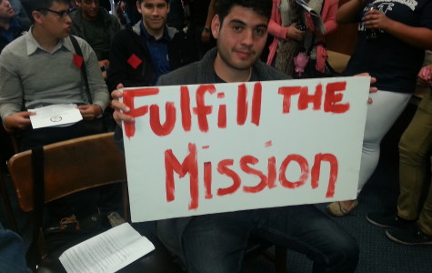Mauri Nunez, member of The Social Equality Club, holds up a sign that reads