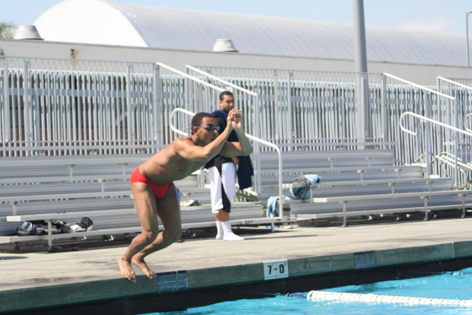 Sophomore Henry Rodriguez seconds away from beginning his lap across the Cerritos College pool. Photo credit: Luis Guzman