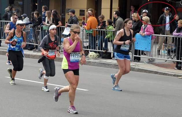 Lorraine Gersitz (far left with the white hat) is running the Boston Marathon on April 15 2013, the red circle indicates the spotting of the two bombers.   Gersitz said the picture