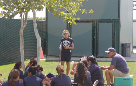 Head softball coach Kodee Murray having a meeting with her players after practice on May 1.