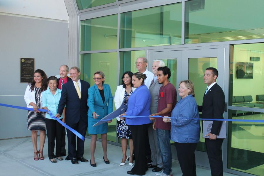 Cerritos college president, faculty, and student president, seen performing the ribbon cutting.