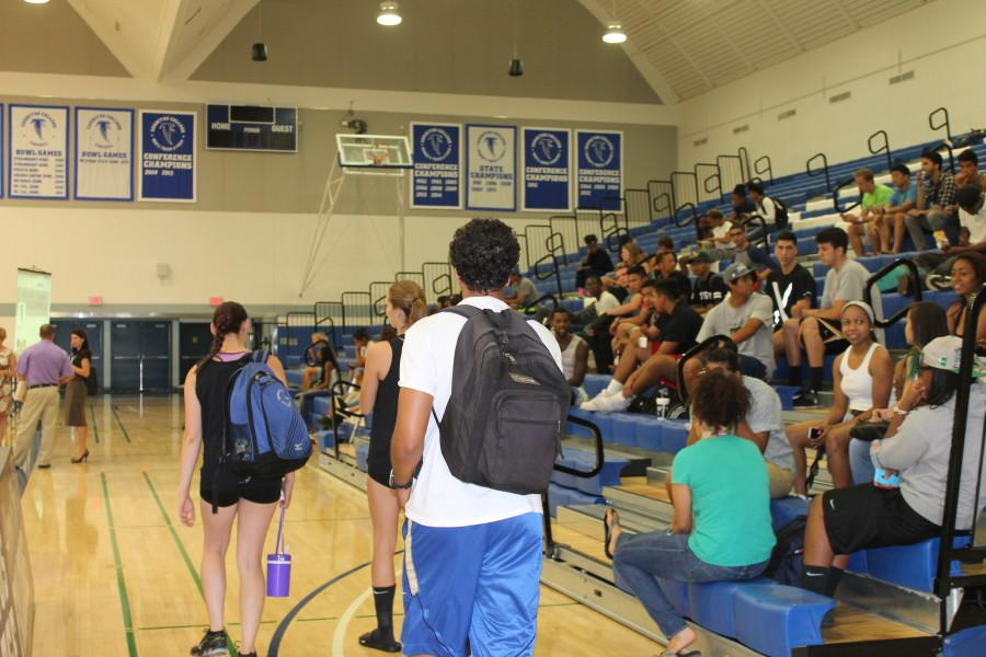 Athletes arrive and wait for the Assembly to begin.