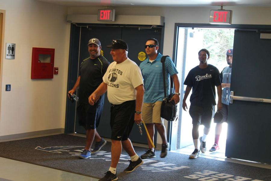 Football Coach, Frank Mazzota and Assistant Baseball Coaches, Hank Zamora and Benny Gonzalez enter the Annual Athletics Assembly.