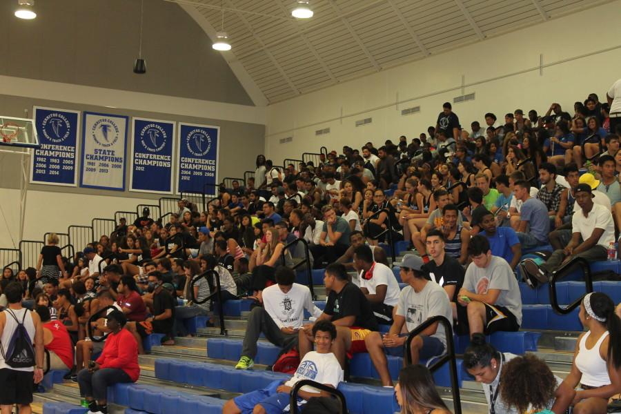 Athletes wait for the assembly to begin