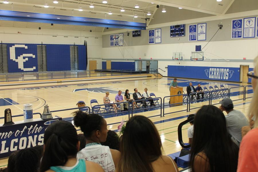 Athletes attentively listen to Dan Clause, Athletic Director of Cerritos College.