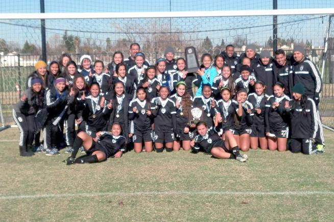 Cornejo is seen here celebrating here with with the Cerritos College women's soccer team after they won the CCCAA State Championship in 2013.