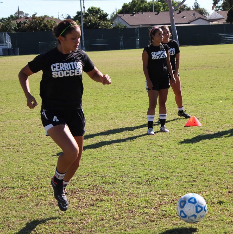 Clara Gomez is working on some ball handling drills. Photo credit: Alexander Naveja