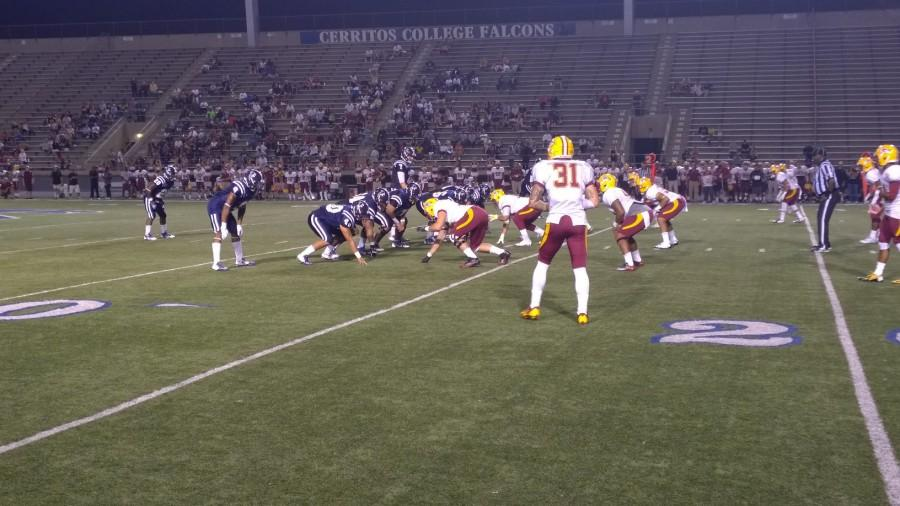 Cerritos College faced Saddleback College in its season-opener. Here, Quarterback Jimmy Walker gets ready to snap the ball to execute a play. Photo credit: Grester Celis-Acosta
