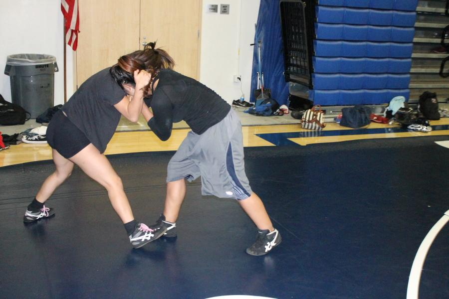 "Two souls: Adriana Alcaraz and Jennifer Anaya are two female athletes that are part of the wrestling team. ""They work hard enough; they should be there,"" Jesse Mastron said."