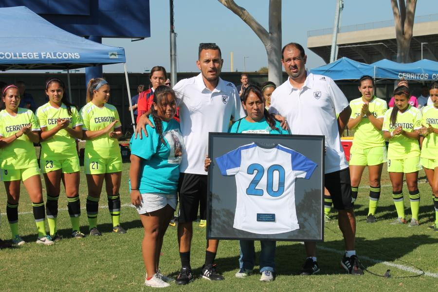 Mother and Sister of fallen athlete Jasmine Cornejo, Rosario Vasquez and Jacqueline Vasquez, honor her jersey along Head Coach Ruben Gonzalez and Assistant Coach Octavio Marquez.