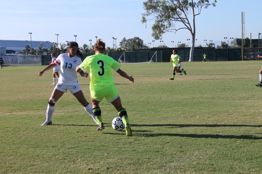 Sophomore and Forward Ashley Anaya-Webb dribbles and jukes past defender for a great build up play.
