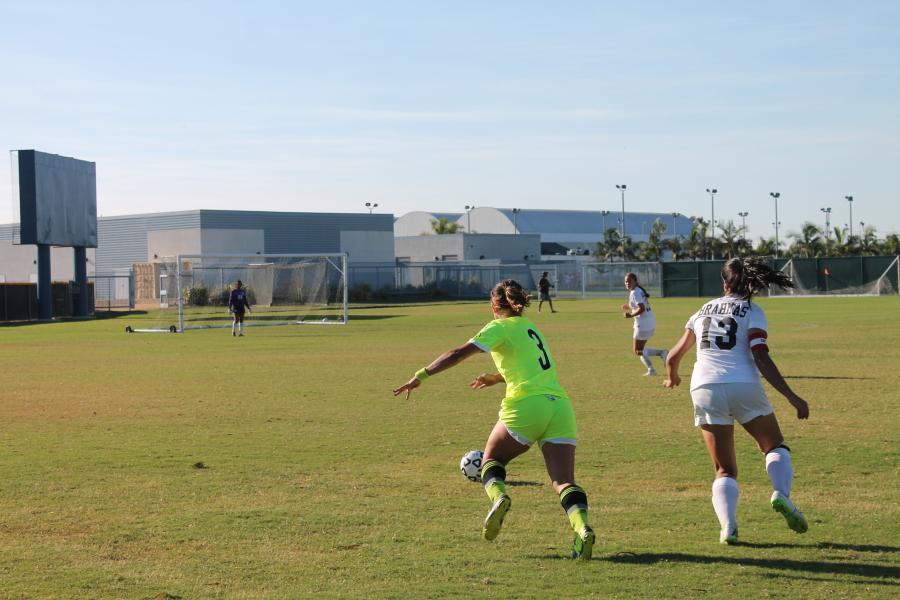 Forward Ashley Anaya-Webb skips past defender for a goal scoring opportunity.