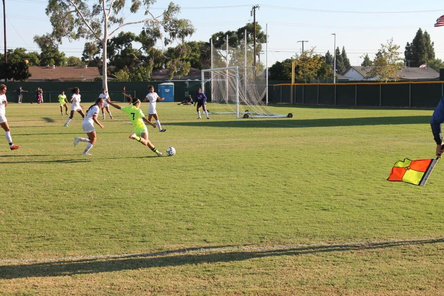 Forward Tiffany Castillo crosses in for an assist to teammate Caroline Omelas who heads in the final goal of the game.