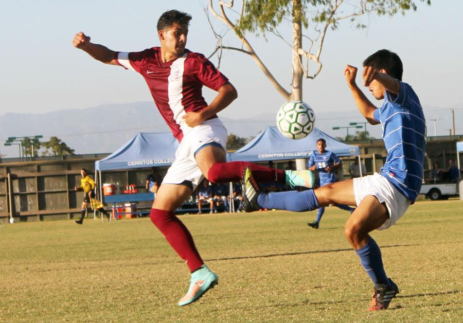 Midfielder Ludwing Vargas trying to capture an air ball.  The Falcons were unable to score against ECC Compton as the game in a 0-0 draw.