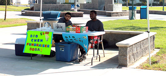 Babak Ghandchi (left) and Richard Hargrove (right) participated in a fundraiser for the Bio-Chem Club. They sold Boba drinks in Falcon Square to raise money for future use in Bio-Chem Club activities. Photo credit: Maria Lopez