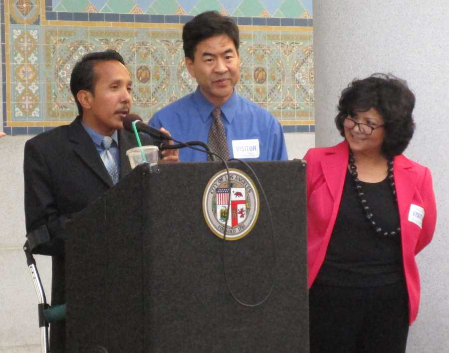 Brian Gutierrez, a sociology major, expresses his experience at Los Angeles City Hall. Next to him are his mentors, Mark Sakata, a counselor at Pasadena City College, and Adriana Miranda, DMD coordinator.