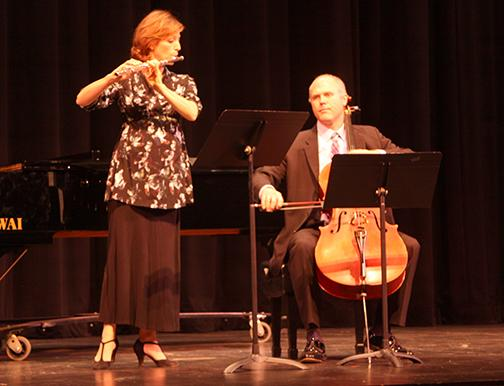 Keren Schweitzer on the flute and Jason Lippmann on cello perform Heitor Villa-Lobos' Assobio A Jato (A Jet Whistle). The pair were the opening act at the Semi-Annual Faculty Gala on Nov. 16 at the Burnight Center Theatre. Photo credit: Gustavo Lopez