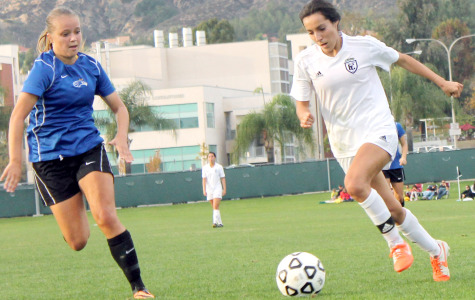 Forward Nayeli Requejo drives the ball against a Santiago Canyon defender in the CCCAA State Champioship game. Requejo would win the Most Valuable Player award.