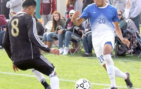 Defender Christian Hernandez maneuvers away from Mt. SAC midfielder Juan Ortega in the CCCAA State Championship game.