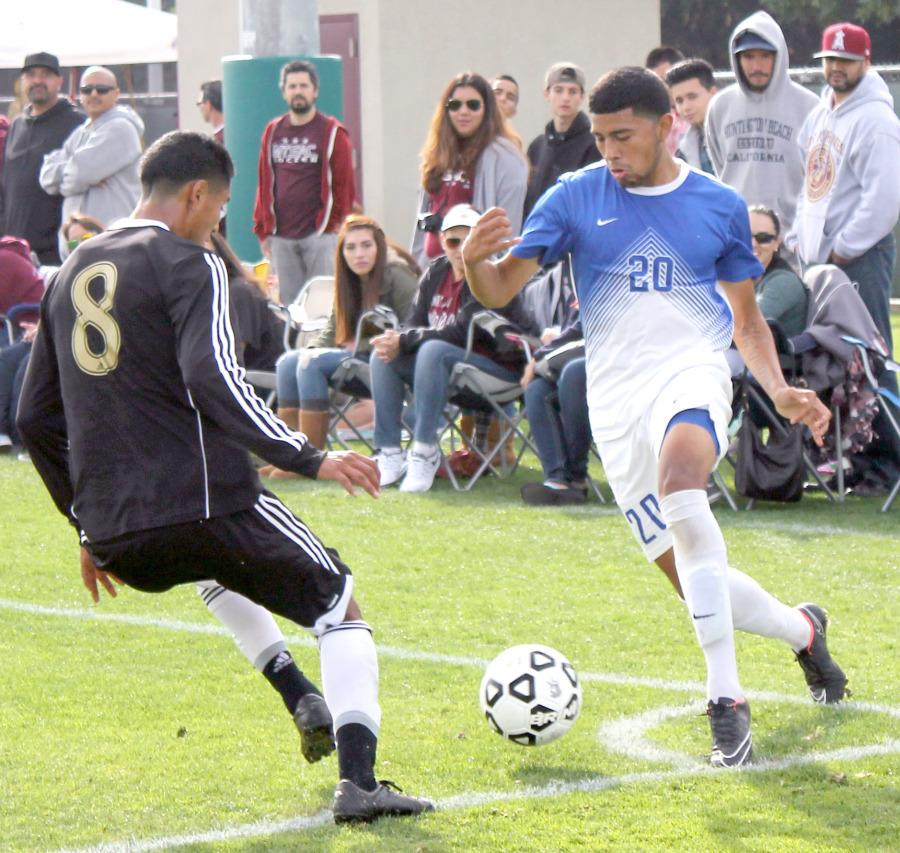 Defender Christian Hernandez maneuvers away from Mt. SAC midfielder Juan Ortega in the CCCAA State Championship game.