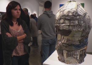 "Fine Arts major Davina Romero looking at Gerardo Monterrubio porcelain sculpture ""Torito"""