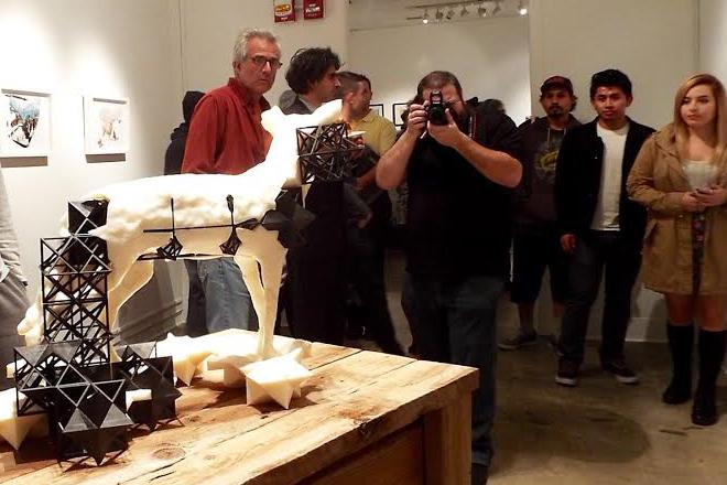 Students, faculty, and community members gathered around artist Jeff Cain's 3D-printed sculpture, scanned from an actual taxidermy coyote that can be seen in the Cerritos College art gallery.