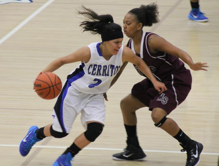 Guard Clarissa Hernandez (left) driving into the paint against Mt. San Antonio on Jan. 23 at Falcon Gymnasium. Photo credit: Armando Jacobo