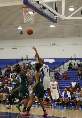 Kennedi Cooper, guard, jumps high enough for a pass to tip the ball in the basket.