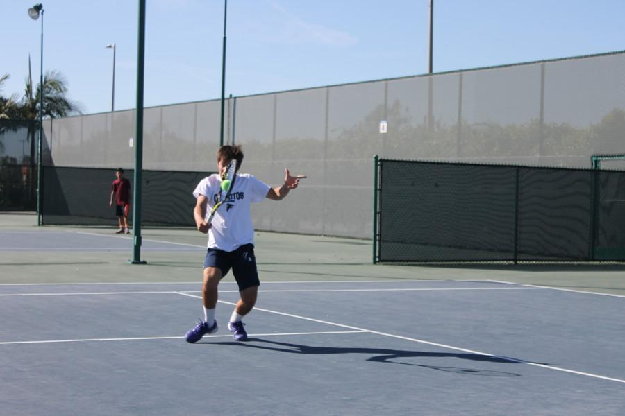 Agustin+Lombardi+in+his+singles+match+returns+the+volley+with+his+backhand.+Photo+credit%3A+Christian+Gonzales