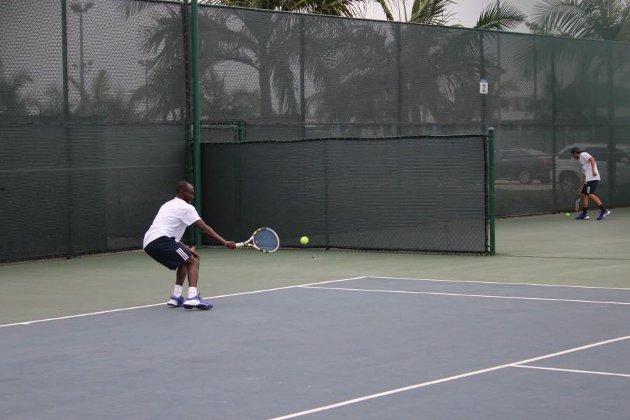 Amadi+Kagoma+Sophomore+in+his+singles+match+focused+on+returning+the+ball+with+his+backhand+Photo+credit%3A+Christian+Gonzales