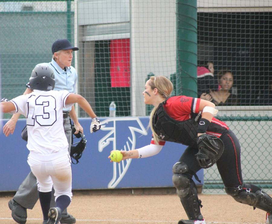 Outfielder Joanna Perruccio scores the first run of the game for the Falcons after avoiding the tag by Dons catcher Annie Dowling. The Falcons won by a narrow score of 3-2. Photo credit: Monica Gallardo