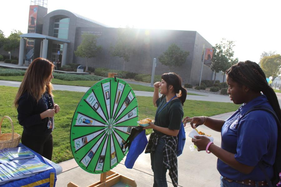 Wednesday Feb. 18 Financial Aid Awareness fair. Students learn about types of financial aid offered at Cerritos College and play games to win prizes. Photo credit: Michael Garcia