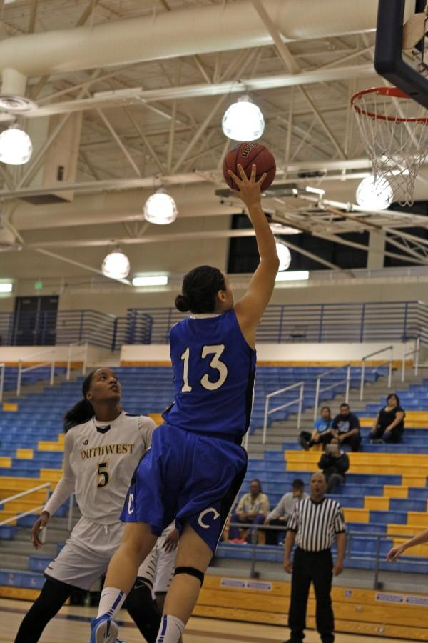 Sydney Lopez makes a two point shot. Photo credit: Emily Curiel