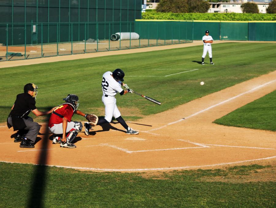 Falcons pitcher/designated hitter Kyle Carpenter connects on a double against Pasadena City College on March 7. Cerritos won the game in blowout fashion 14-3 Photo credit: Mario Jimenez