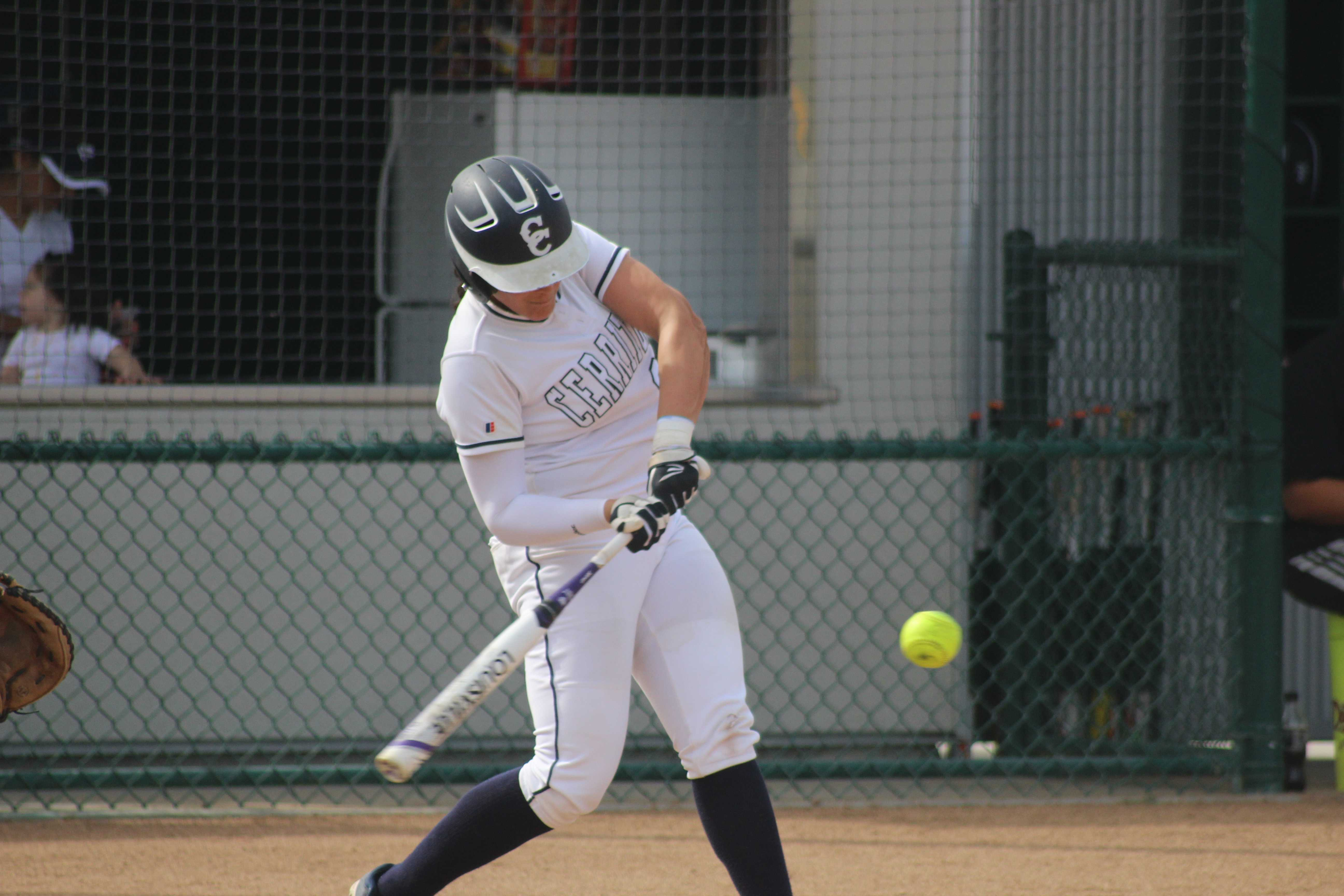 Cerritos catcher Krystal Purkey connects for a grand slam in the first inning. She hit another home run in the fourth for a 16-6 Falcons victory. Photo credit: Monica Gallardo