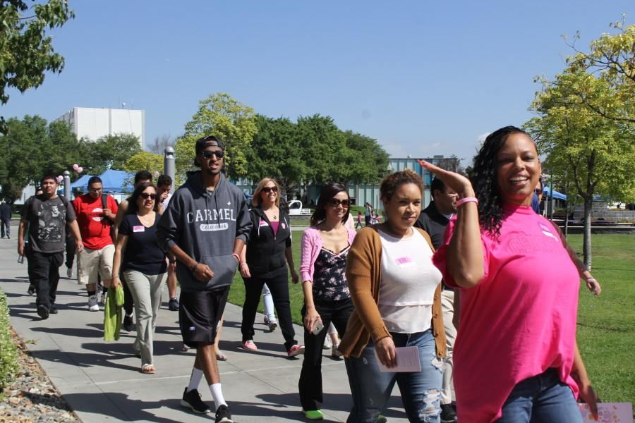 Participants walk for breast cancer awareness in Falcon Square on Tuesday March 24. Photo credit: Lauren Torres