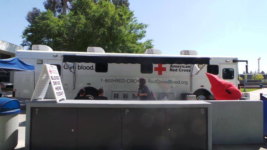 The+American+Red+Cross+donor+bus+in+Falcon+Square+on+April+13.+The+bus+holds+five+beds+so+that+five+donations+are+collected+at+a+time.+Photo+credit%3A+Perla+Lara
