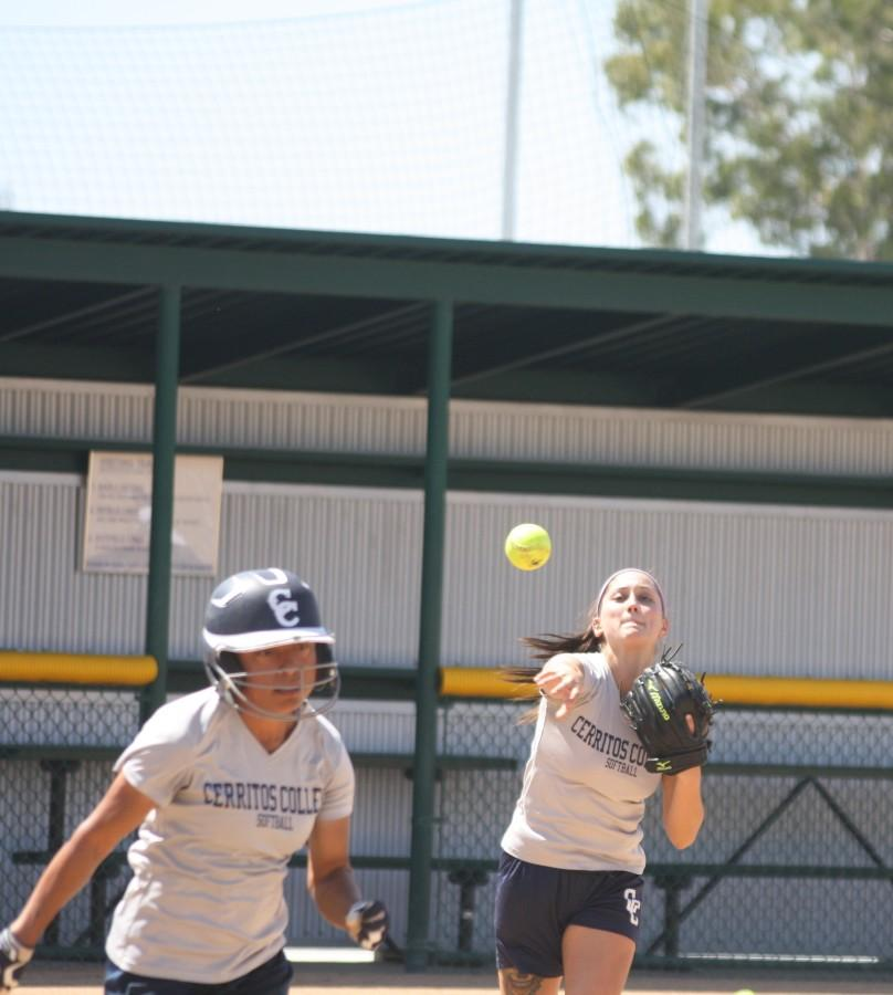 Center fielder Joanna Perruccio attempts to outrun pitcher Ana Pedroza's throw to first. The Falcons are one of the 16 teams that made it to the Southern California Regional Playoffs. Photo credit: Monica Gallardo