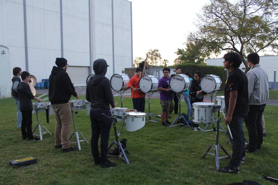 The Drum Line in mid-practice outside of the music department. They typically meet two hours before their class starts. Photo credit: Lauren Torres