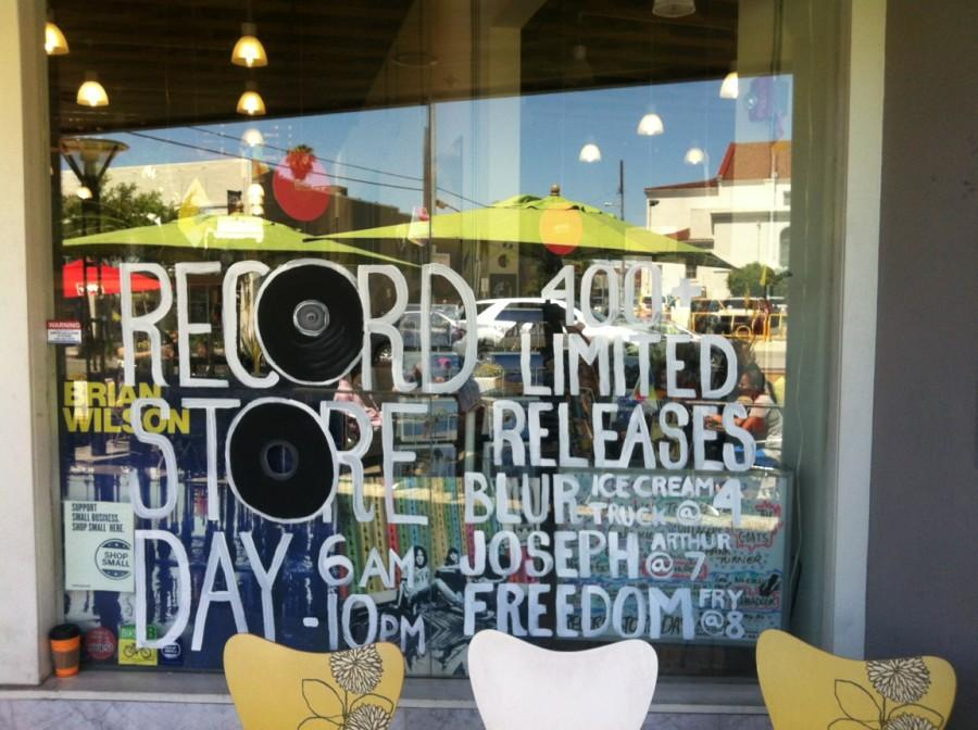 Record Store Day promotes itself on the front window of Fingerprints Records. Photo credit: Lauren Torres