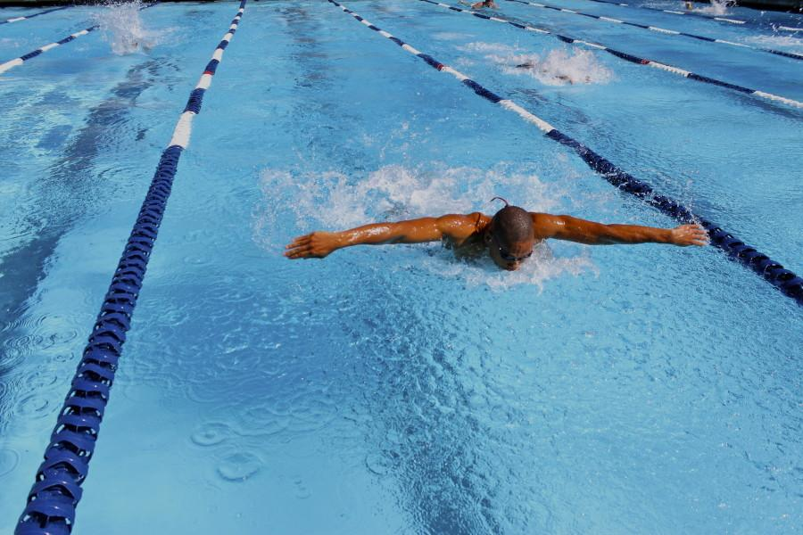 Butterflystroke swimmer Joshua Owens finishes is his last 100m stroke at Conference Meet. Photo credit: Emily Curiel