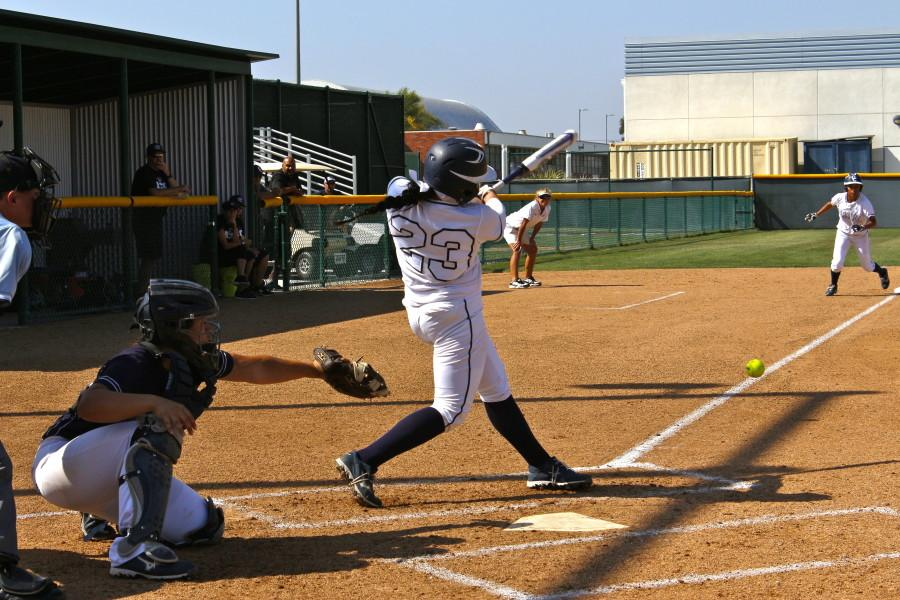 Catcher number 23 Krystal Purkey hitting a two-run home run against El Camino College. Photo credit: Emily Curiel
