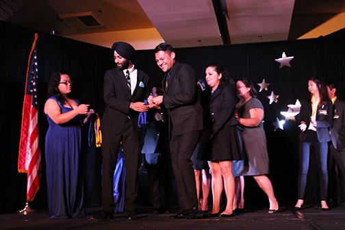 PBL members Aldemar Sanchez, Johanna Hernandez and Roxanna Lopez recieving fifth place in hospitality management from Director of Membership Angad Singh Padda. Several of the competitions were ones compromised of group efforts. Photo credit: Gustavo Lopez