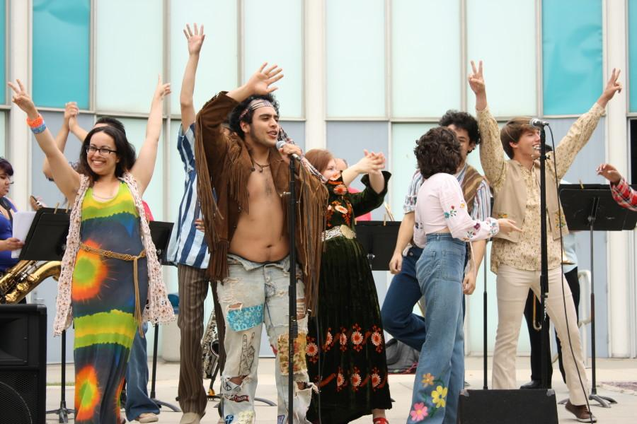 The cast of HAIR rally the crowd at an anti-war rally from left to right: Maya Hasiba Ohayon, Ivan Oyarzabal, Natasha Lopez, Emma Simons-Araya, Isaac Simons-Araya and Samuel Green. Courtesy of Renee Bloch