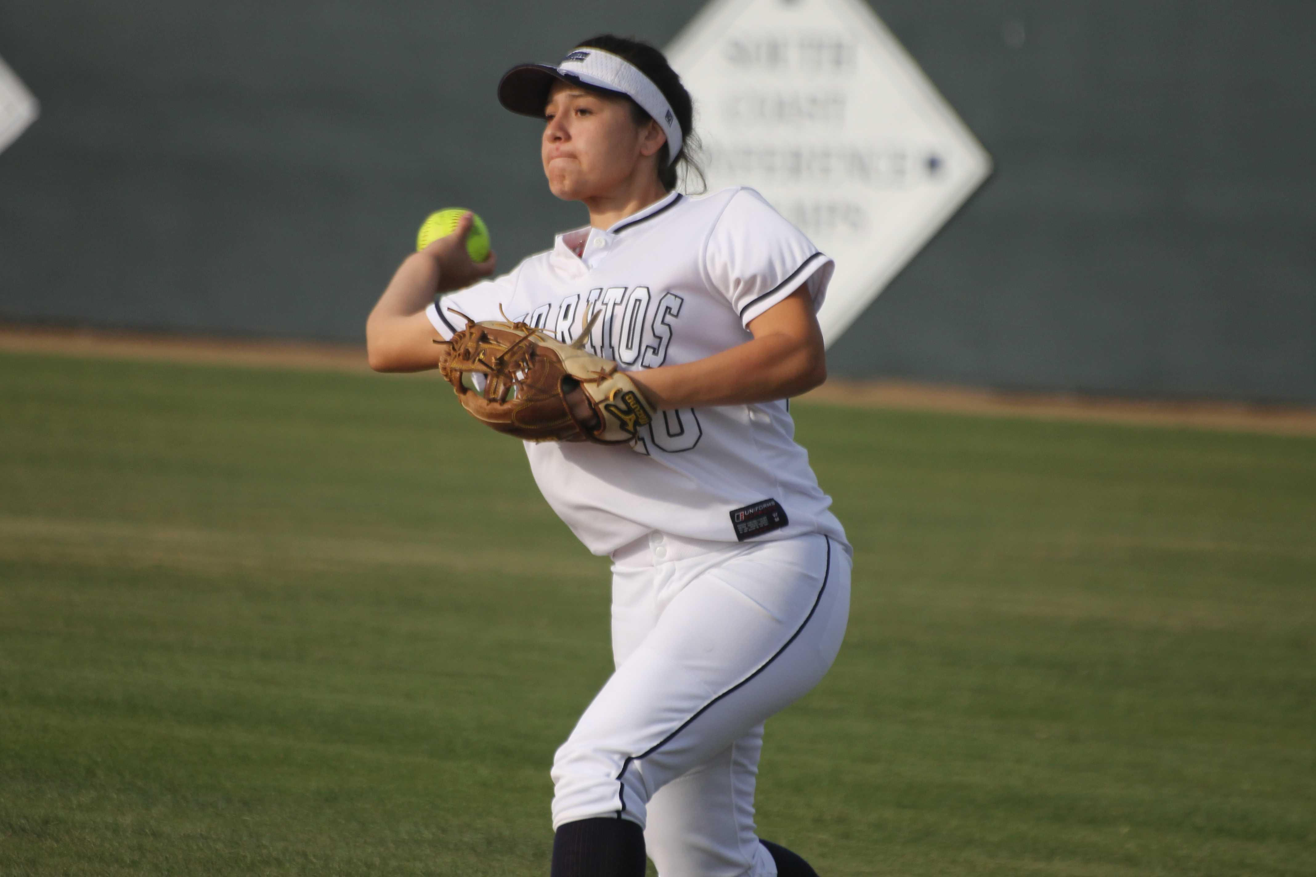 Second baseman Monique Ramirez attempts to get the out during the February 20 game against College of the Canyons. The Falcons ended their season with a 26-19 record. Photo credit: Monica Gallardo