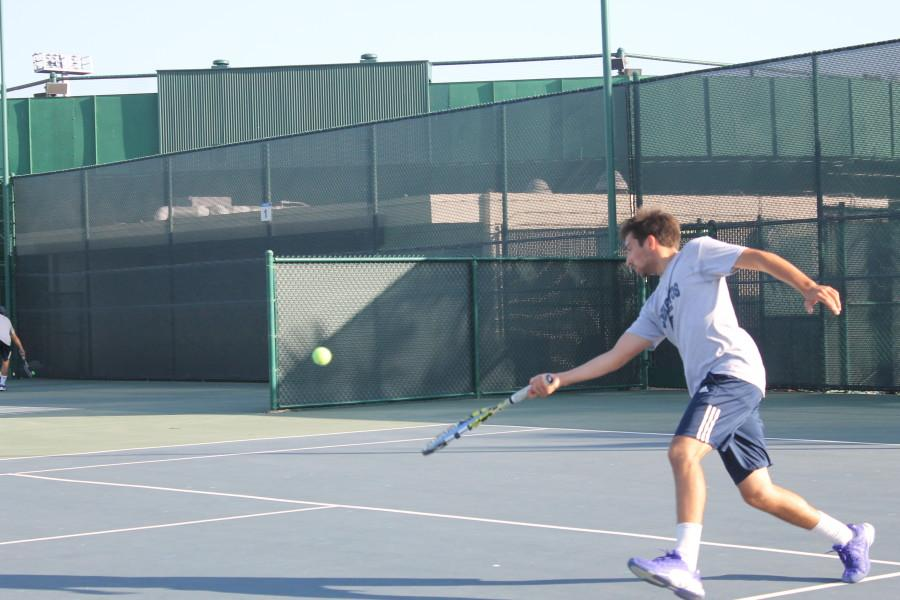Agustin Lombardi returns the ball as he approaches the net in his singles match. He went 20-6 in singles matches this season. Photo credit: Christian Gonzales