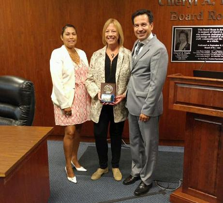 Left to right:  Carmen Avalos, Margo Winners, Dr. Jose Fiero. Margo Winners, graphic designer, was awarded the Classified Employee of the Month for July 2015 during the Wednesday Aug. 19 board of trustees meeting.