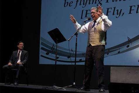 After introducing new employees and recognizing achievements, College President, Dr. Jose Fierro (left), receives a special surprise from Professor David Betancourt (right). He and staff members of Cerritos perform a song entitled Fierro